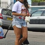 Alex Scott in a Blue Daisy Duke Shorts Was Seen Out in North London