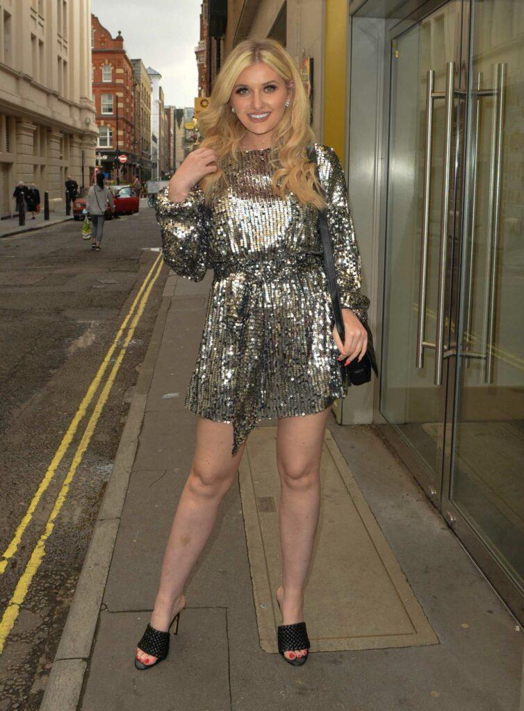 Amy Hart in a Silver Mini Dress