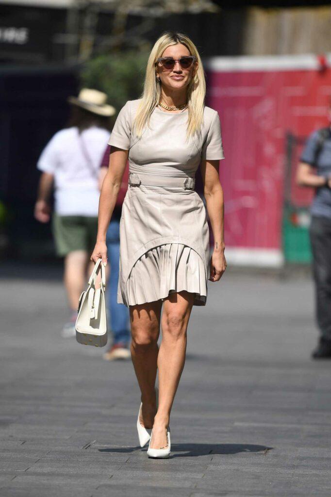 Ashley Roberts in a Beige Dress