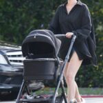 Elsa Hosk in a Black Shirt Goes on a Stroll with Her Daughter in Pasadena