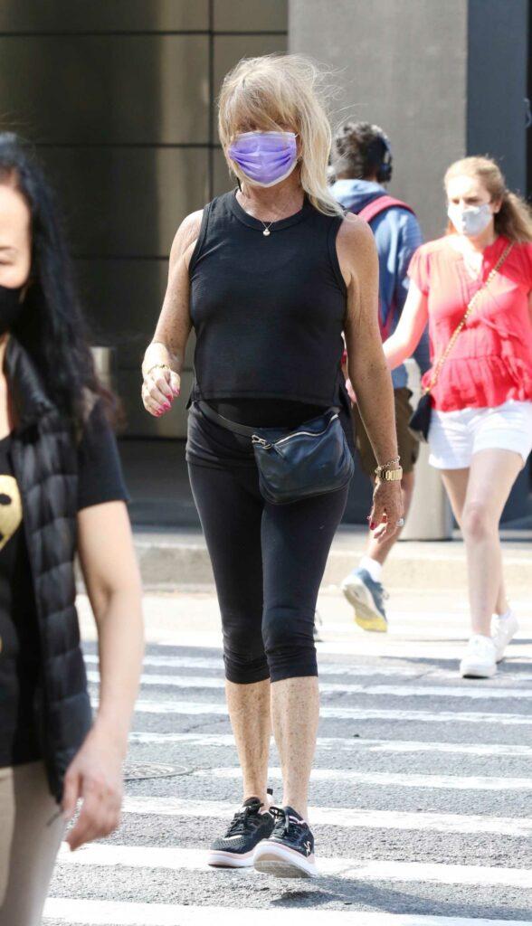 Goldie Hawn in a Black Sleeveless Shirt