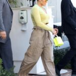 Jennifer Lopez in a Yellow Top Leaves Lunch with a Friend at San Vicente Bungalows in West Hollywood