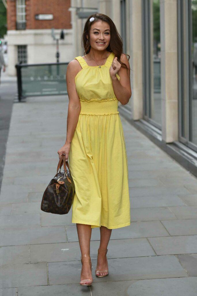 Jess Impiazzi in a Yellow Dress