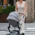 Karlie Kloss in a Beige Dress Takes a Stroll with Her Baby Levi in New York