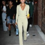 Karrueche Tran in a Yellow Outfit Steps Out for Dinner with Friends at TAO Restaurant in Los Angeles