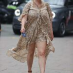 Kelly Brook in a Beige Dress Arrives at the Heart Radio in London