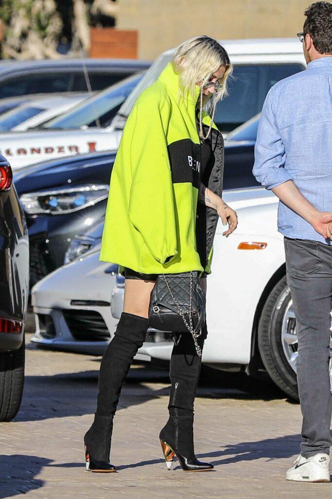 Kesha in a Neon Green Belenciaga Jacket