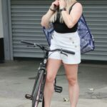 Sian Welby in Tiny White Shorts Was Seen on Pink Bicycle in London