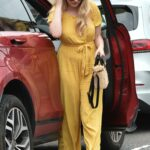 Amy Hart in a Yellow Catsuit Arrives at Theatre in Portsmouth