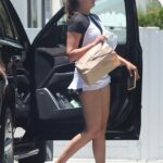 April Love Geary in a White Sneakers Arrives for a Tennis Class in Malibu