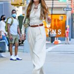 Gigi Hadid in a White Suit Arrives Home in New York