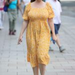 Kelly Brook in a Yellow Summer Dress Arrives at the Heart Radio in London