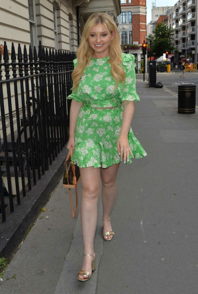 Amy Hart in a Green Floral Mini Dress