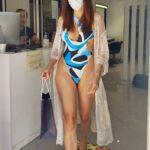 Blanca Blanco in a Blue Patterned Swimsuit Visits a Hair Salon in Caminia