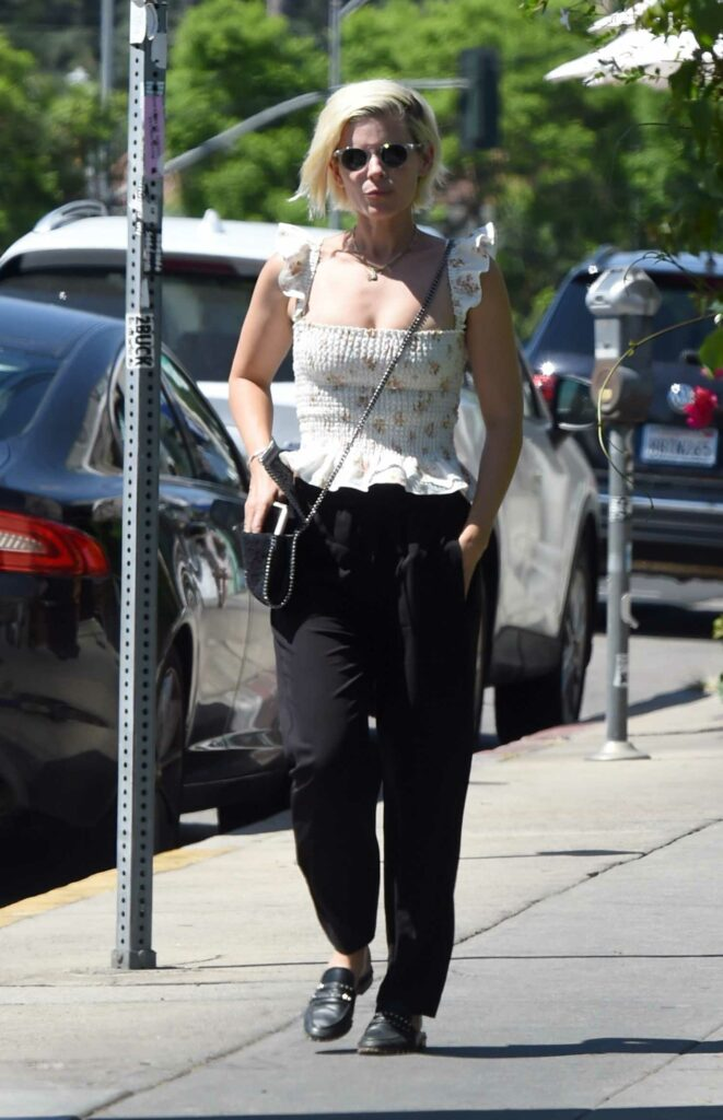 Kate Mara in a White Floral Blouse