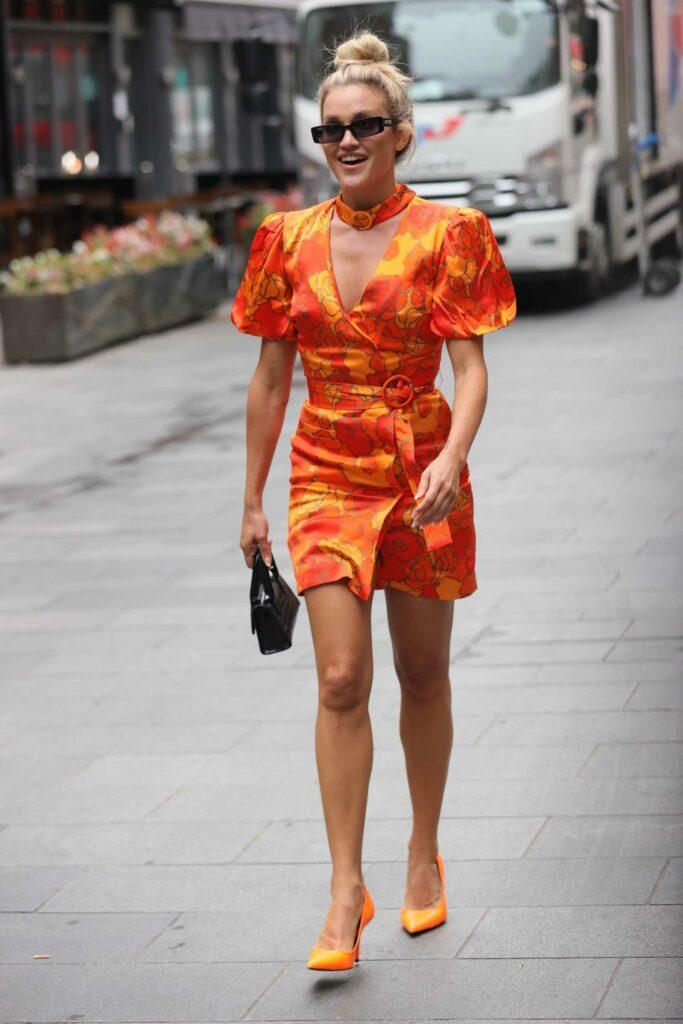 Ashley Roberts in an Orange Mini Dress
