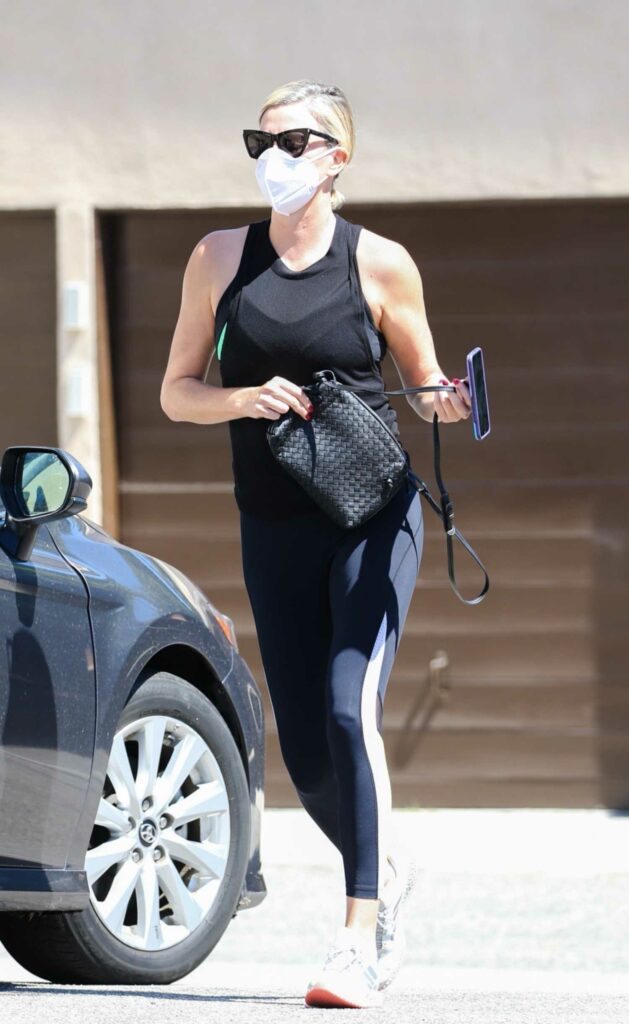 Charlize Theron in a Black Tank Top