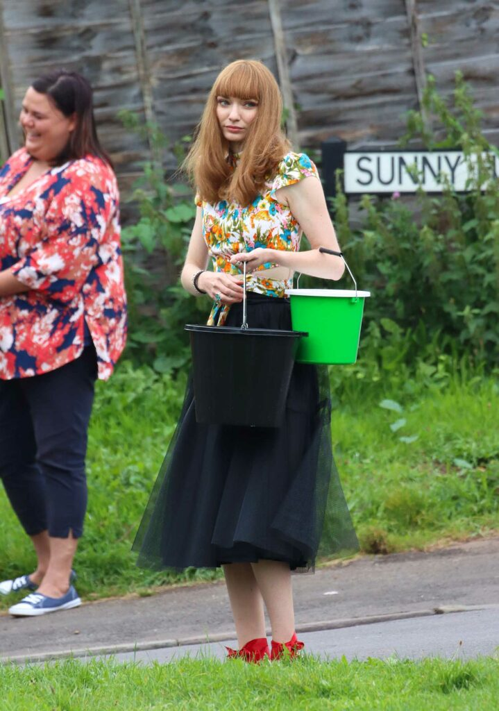 Eleanor Tomlinson in a Floral Blouse