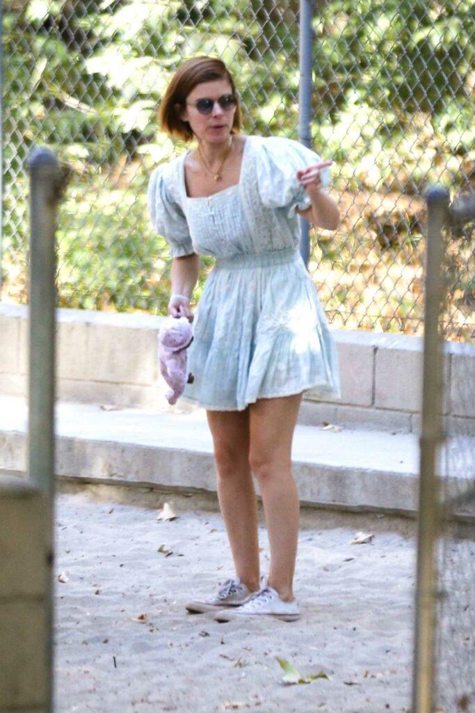 Kate Mara in a White Sneakers