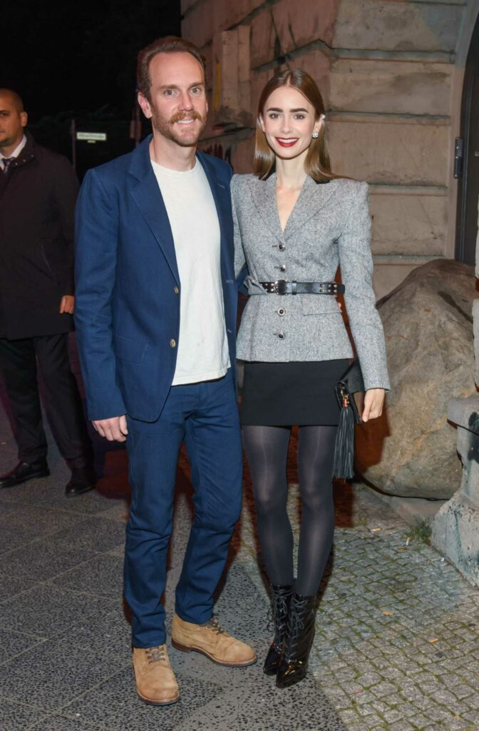 Lily Collins in a Grey Blazer
