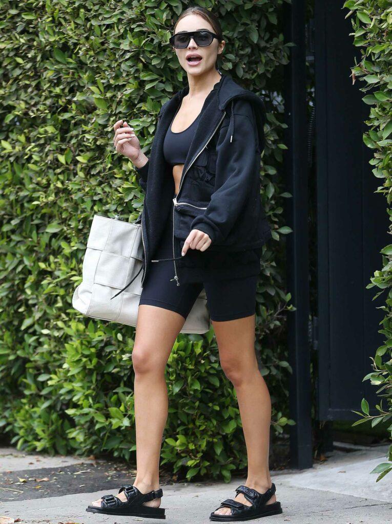 Olivia Culpo in a Black Spandex Shorts