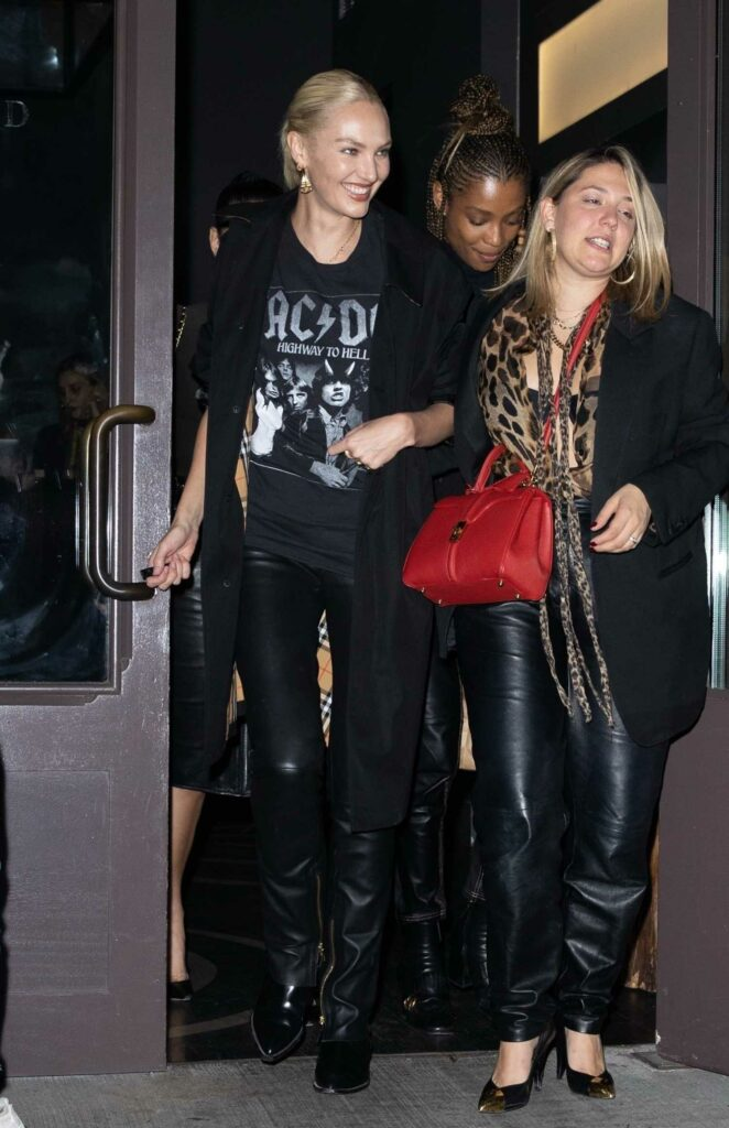Candice Swanepoel in a Black ACDC Tee