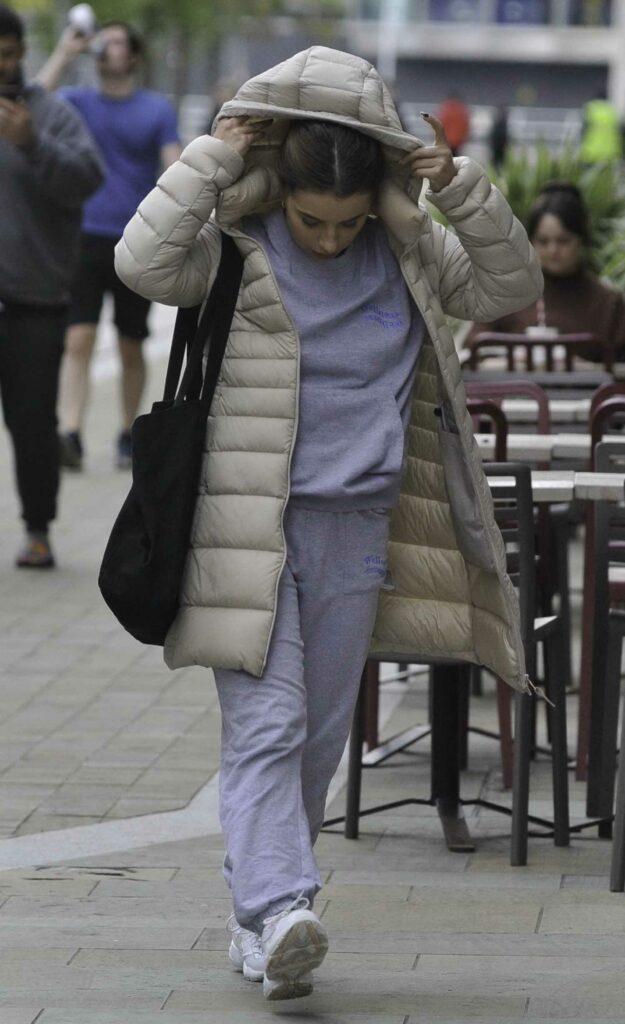 Charlotte Jordan in a Beige Puffer Jacket