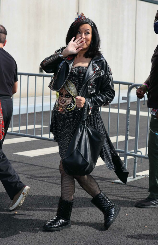 Jennifer Tilly in a Black Leather Jacket