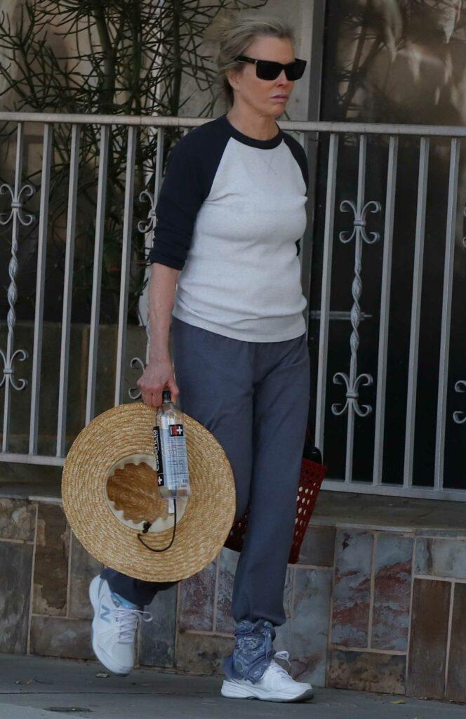 Kim Basinger in a White Sneakers