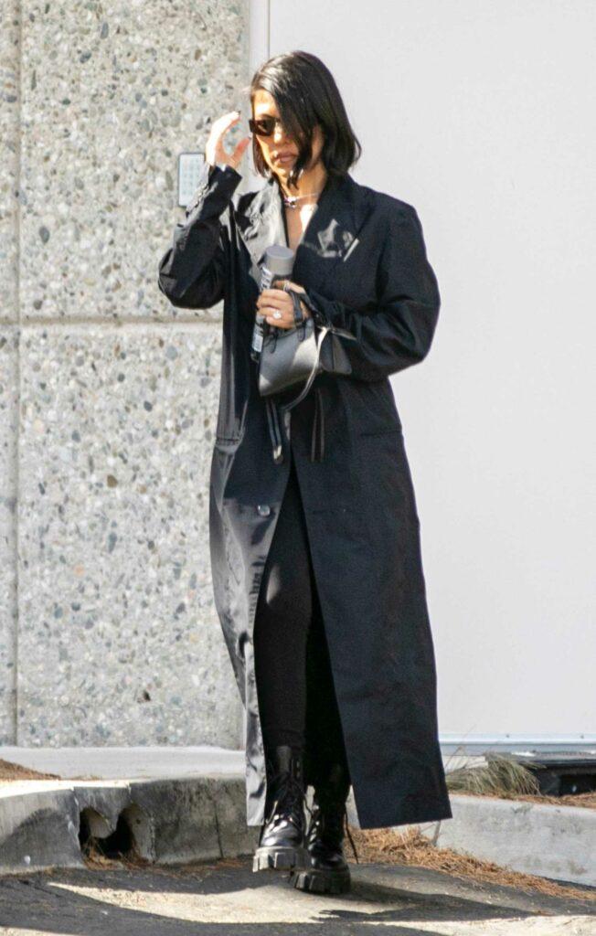 Kourtney Kardashian in a Black Trench Coat