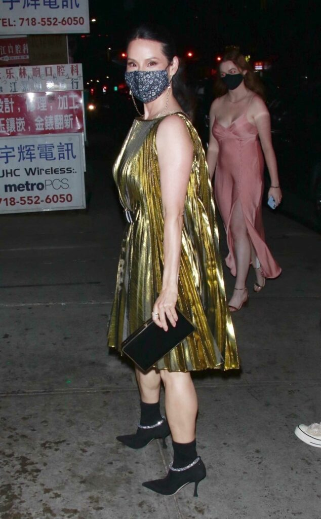 Lucy Liu in a Shiny Gold Dress
