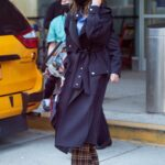 Victoria Beckham in a Black Coat Arrives at JFK Airport in New York