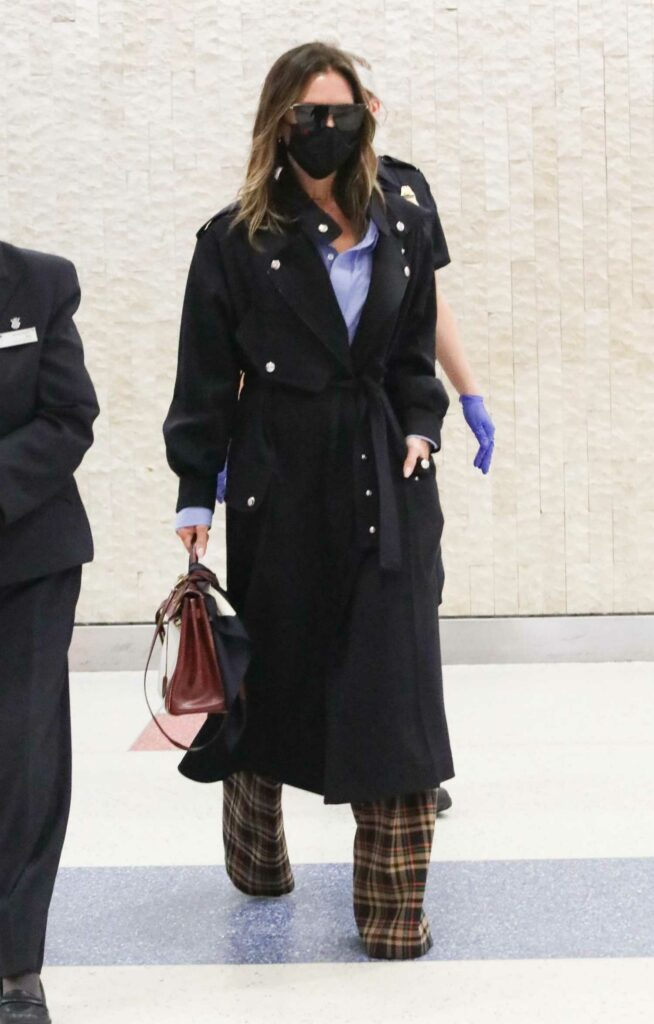 Victoria Beckham in a Black Coat