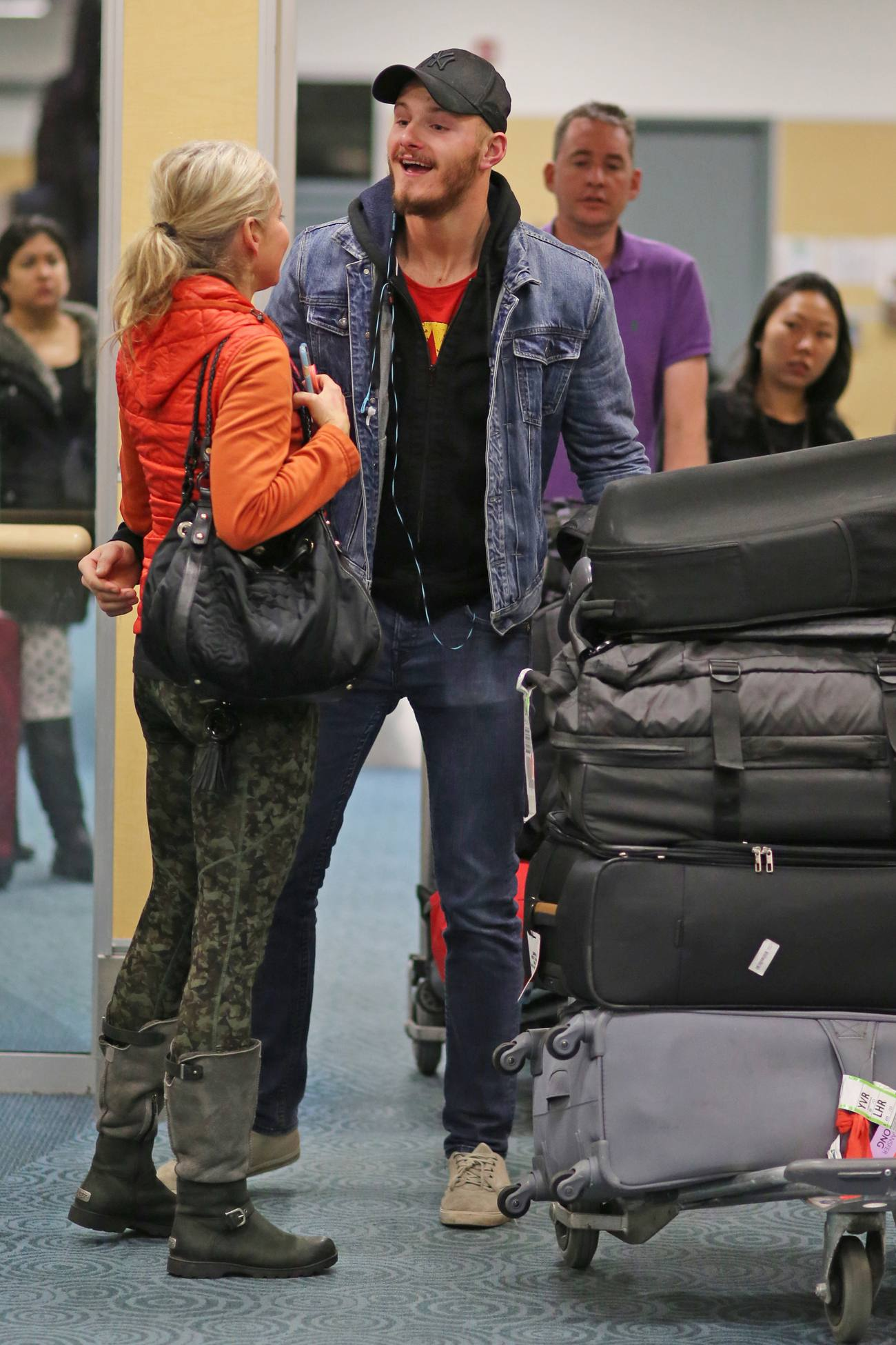 Alexander Ludwig Gets A Warm Welcome From His Mom and Fans at LAX Airport-1