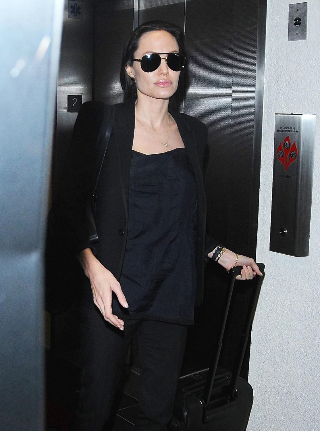Angelina Jolie and her son Maddox Arrive at LAX Airport-1