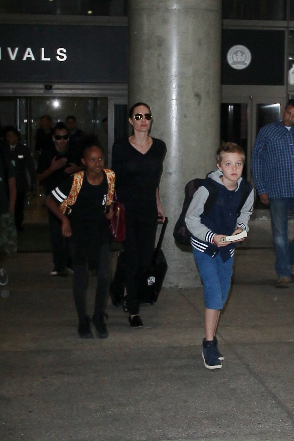 Angelina Jolie Arrives at LAX Airport With Her Kids-1