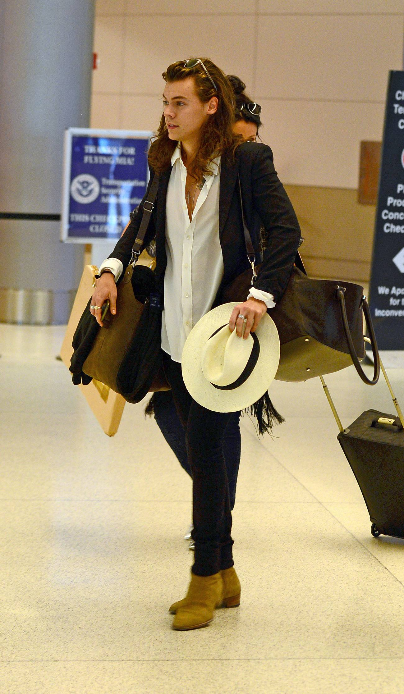 Harry Styles Arrives At Miami Airport Celeb Donut