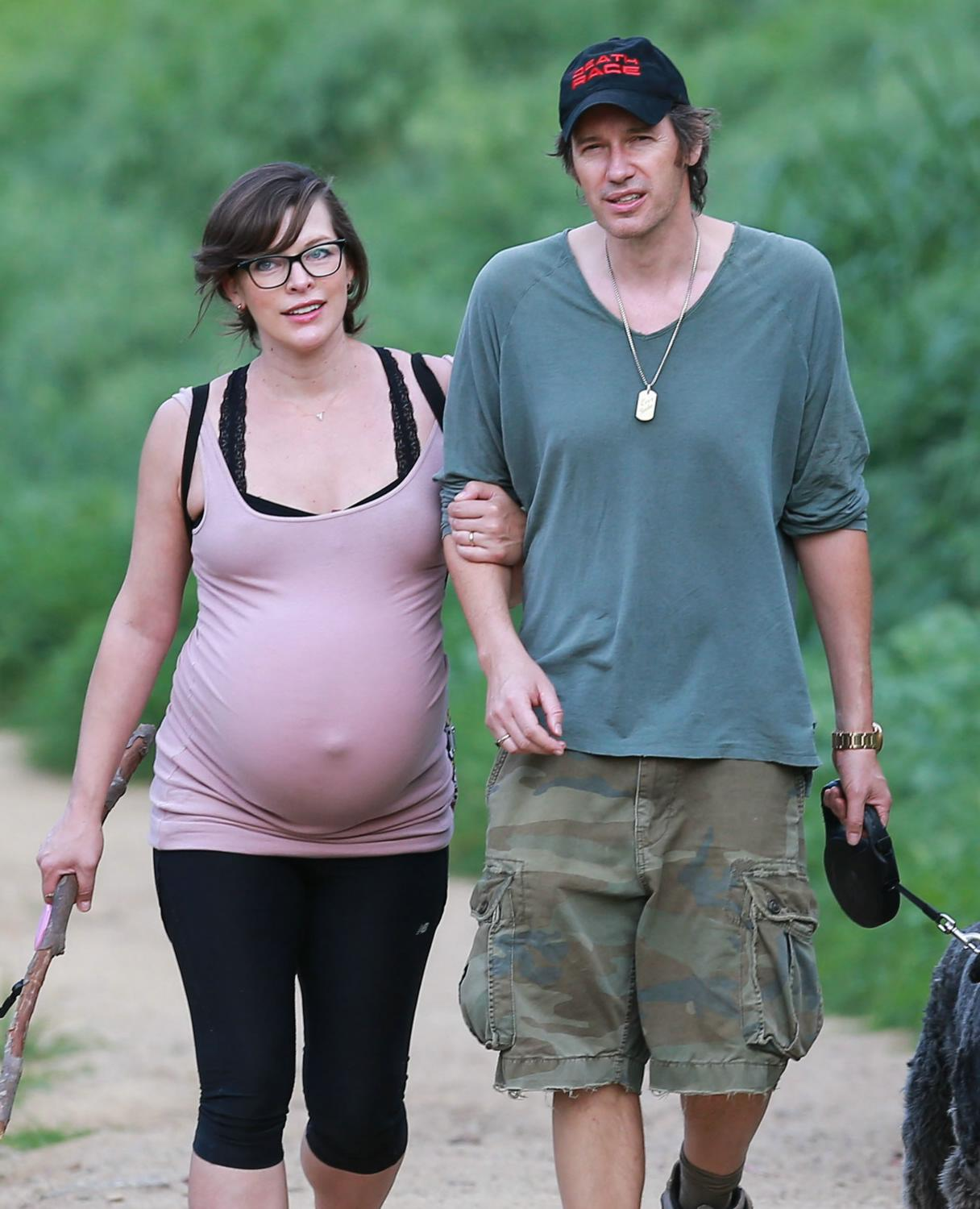 Milla Jovovich and Paul W.S. Anderson Hiking With Their Dog-1