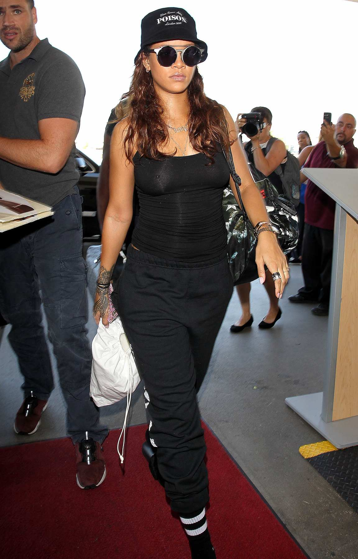 Rihanna Wears Black Outfit To LAX Airport-2