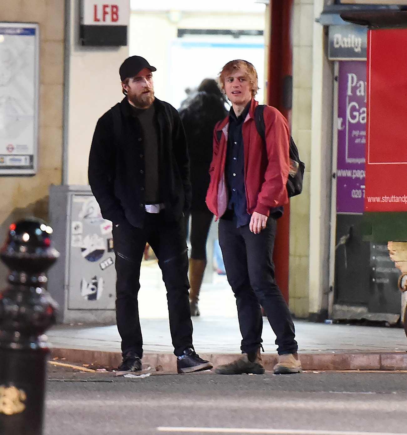 Robert Pattinson Leaving Underground Station With A Friend-1