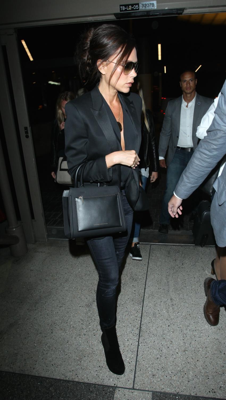 Victoria Beckham is seen making her wayrough LAX Airport-4